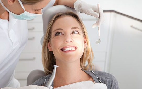 Smiling at Dental Surgeon dental implants